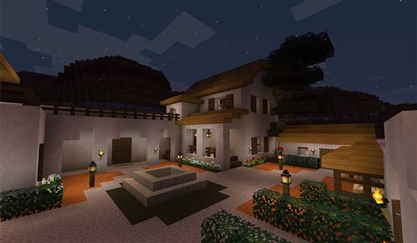 Image where we can see the garden of a big plot, with a house, decorated with the textures of the texture pack Medial.