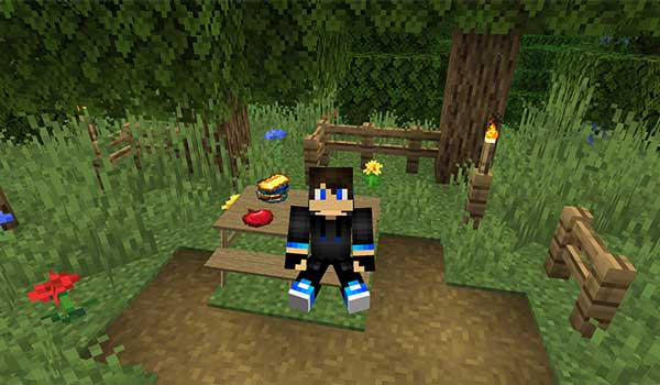 Image where we can see a player sitting on one of the picnic tables that we can build with the Benched Mod.