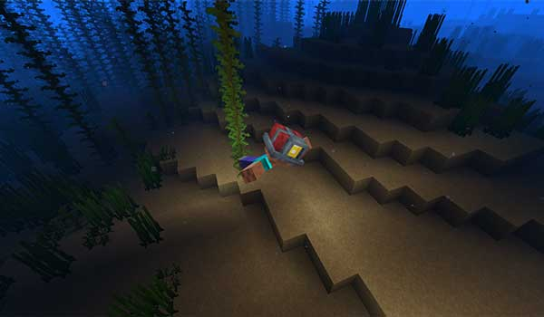 Image where we see a player exploring the sea floor with the helmet provided by the Miner's Helmet Mod.