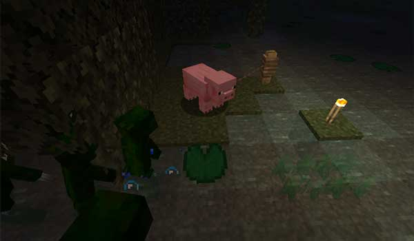 Image where we can see a group of humanoid frogs, from the Froglins Mod, heading towards a pig.
